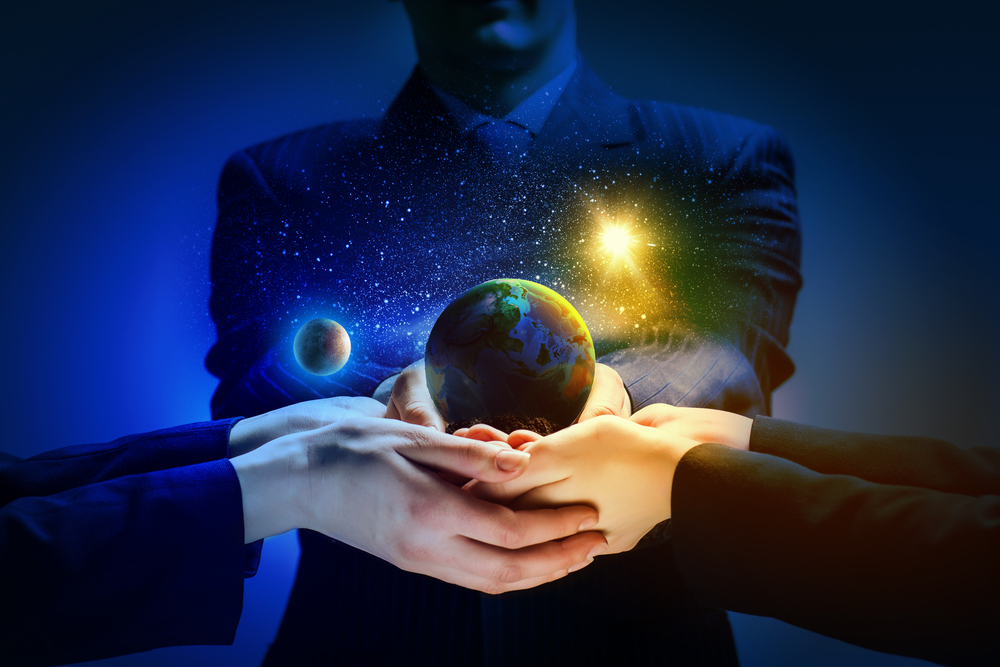 Close up image of human hands holding earth planer. Ecology concept